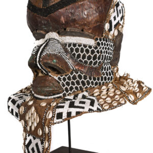 Object Royal Mask Ethnic group: KUBA, Bushoong Bwoom Country: DR Congo Material: Wood, Beads, Cauris, Copper Period: Mid 20th century Sold with stand: No Dimensions: 40x30x30 cm Weight: 2500 gram Condition: Good condition, used with some signs of wear